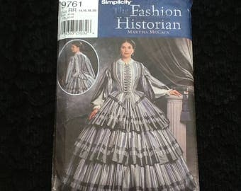 Simplicity pattern 9761. Uncut misses' Civil War costume. Tiered skirt worn with hoop skirt, fitted blouse worn with corset. Sizes 14-20.