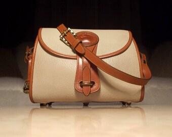 Dooney & Bourke Vintage 1990s All Weather Leather Medium R25 Bone/British Tan Crossbody Handbag: Classic Cool, Natural Beauty