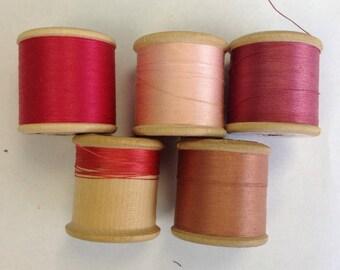 5 Silko wooden cotton reels.