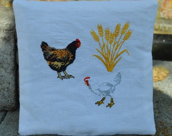 2 white chicken potholders