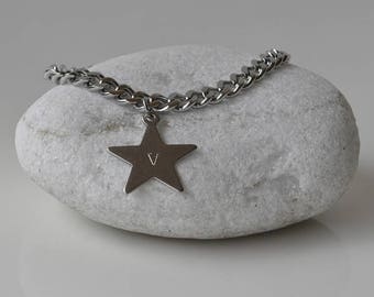 Steel chain bracelet and engraved star