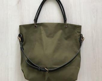 Military green waxed canvas and black leather tote bag