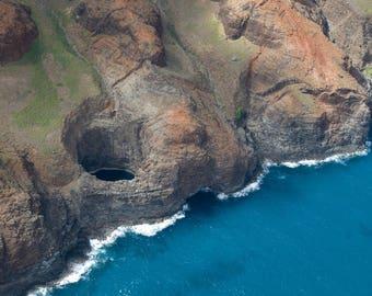 "Aerial view of an exposed cave on the Na Pali Coast in Kauai, Hawaii  - ""Porthole"""
