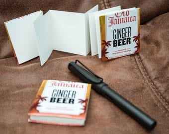 Recycled ginger beer can books, a set of two small note books.