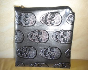 handmade skull with black/gray waxed canvas clutch