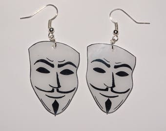These earrings... anonymous white masks