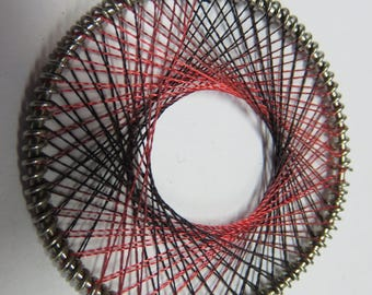 Red and black woven wire metal disc