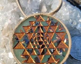 Sri yantra orgonite glow in the dark crystal pendant