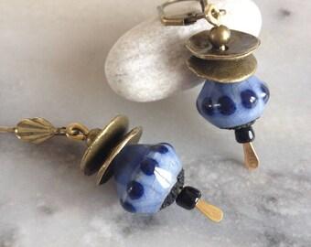 Bohemian and rustic earrings, blue raku ceramic tops lapis, bronze metal.