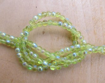 Wire of approximately of 78 dyed 4 mm transparent glass beads: lime green.