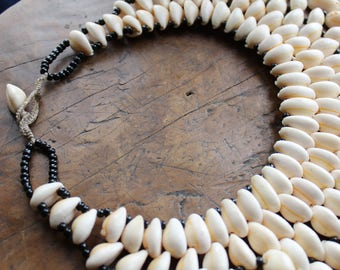 Cowry / Cowrie shell waterfall necklace, layers and tassels of shells. a statement necklace, fun eye candy