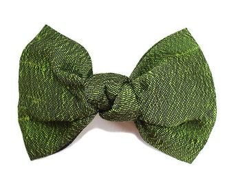 Hair bow knotted green silk fabric.