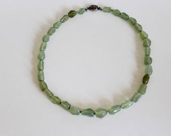 Beautiful jade necklace with silver clasp.
