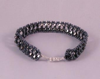 Bracelet in Swarovski crystal hematite color 2x.