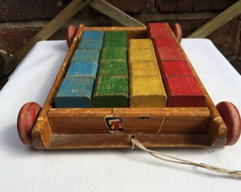 Vintage Tri-ang pull along wagon with blocks