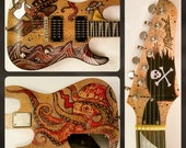 7 String Electric Guitar, Giant Octopus vs Ship. Release the kraken and wail on this great paying instrument! Hand decorated, one of a kind.