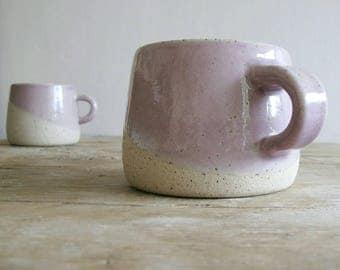 """Stoneware pottery mugs in a pretty """"cherry blossom"""" glaze."""