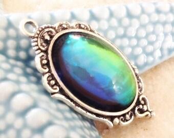 Silver /cabochon glass cabochon iridescent blue green metal pendant / handmade