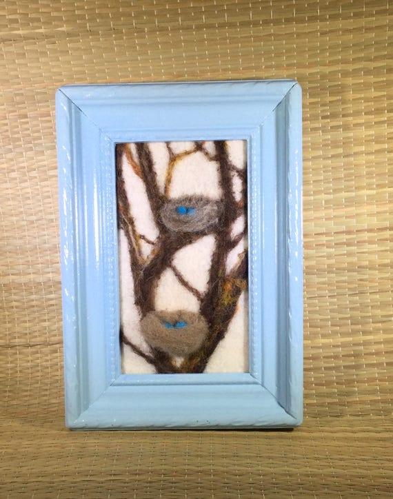 Felted bird nest with blue bird eggs