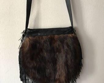 Hand made real fur woman bag .