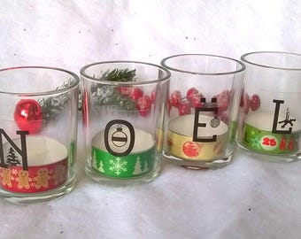 4 Christmas candles. Available decorated tealight candles