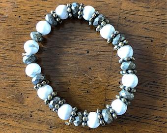 8mm howlite, 7mm rondelle pyrite, antique brass floral bead stretch bracelet