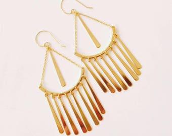 Long dangling golden earrings.