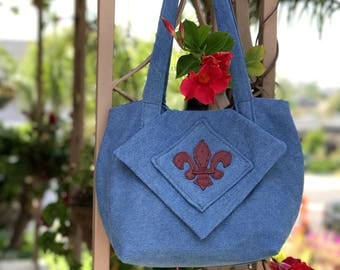 Denim handcrafted, original handbag/shoulder bag with burgundy fleur de lis decoration.