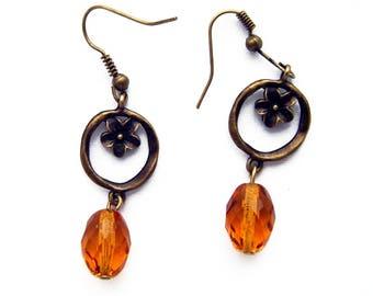 Beautiful earrings in metal bronze