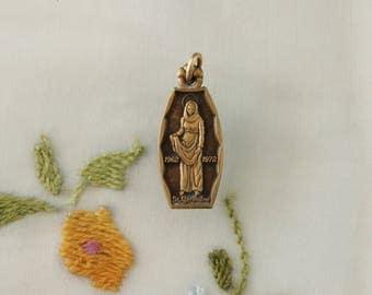 Vintage St. Germaine Cousin Brass Medal