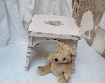 Sweet little vintage pink stool with cut out detail.