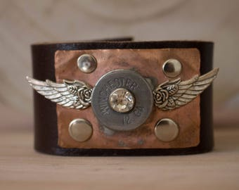 Genuine leather cuff in Chocolate brown with a Winged Winchester bullet Soldered on Copper