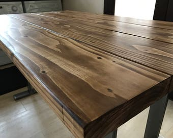 Reclaimed solid wood table on industrial stainless steel legs