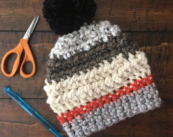 The Ultimate Fall Beanie | Crochet Hat with Neutral and Orange Stripes and Black Puffball | Stylish, Warm, Cozy Kids Hat