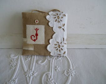 Embroidered initial cross stitch door cushion
