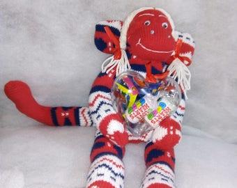 valentino- sock monkey holding sweets