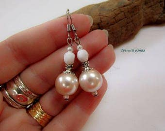 White and pearl earrings.