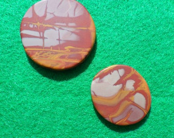 Noreena Jasper set of two (one large, one small) golf ball markers
