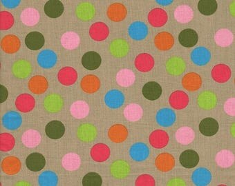 Multicolored bubbles traveling on a Beige background
