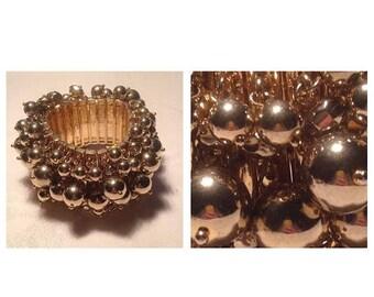 On Sale Fabulous Large Goldtone Stretchy Bracelet