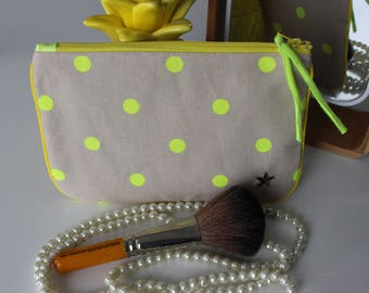 Neon yellow dot pouch