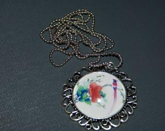 Baroque cabochon tropical bird pendant