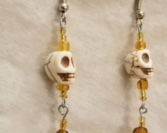Creepy Amber Skull Earrings Skulls