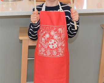 Olivia Ladybird Child's Apron in red, Scandi style Christmas gift for cookery fun with the kids