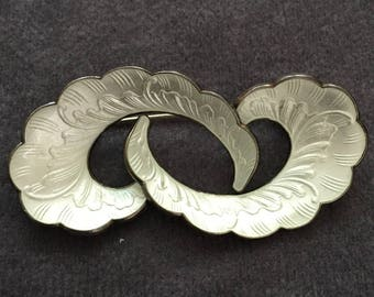 Ivar T. Holth silver and white enamel brooch