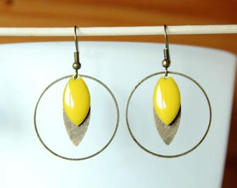 earring with bright yellow enameled sequin and bronze color finish
