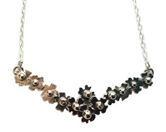 Silver forget me not flower statement necklace