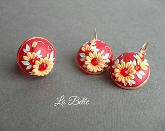 Set of earrings and a ring of floral filigree