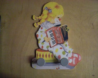 LITTLE GIRL CLOWN ACCORDION WALL RACK