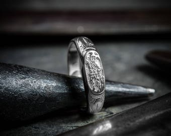 Silver ring with St. George